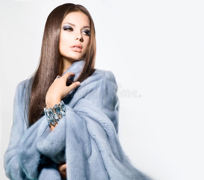 Girl In Blue Mink Fur Coat Royalty Free Stock Photography