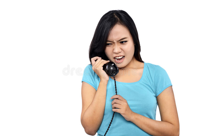 Girl In Blue Shirt Look Angry Talking On The Phone stock image