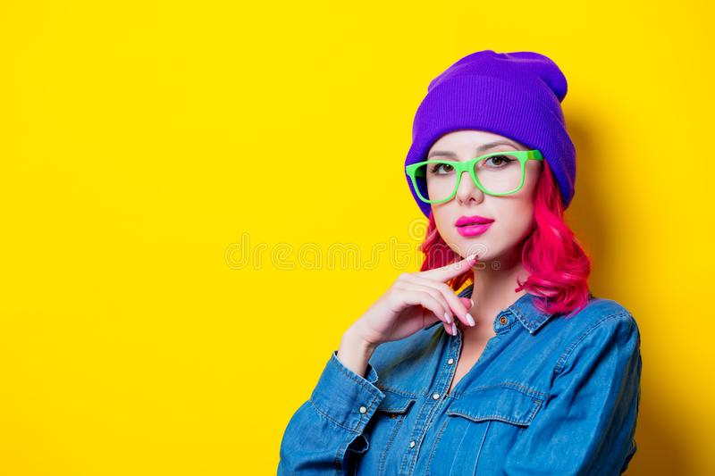 Girl in blue shirt, purple hat and green glasses royalty free stock photos