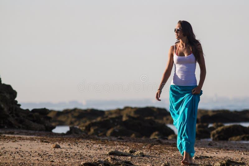 Download Girl In Blue Skirt On Beach Stock Image - Image of sunglasses, girl: 25945519