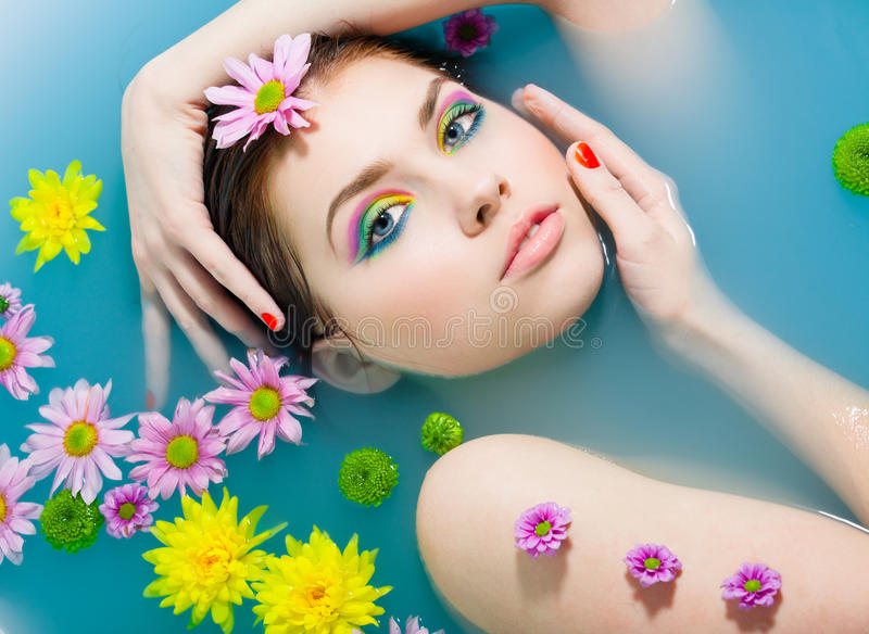 Girl in a blue water. Young pretty girl in blue water stock photography