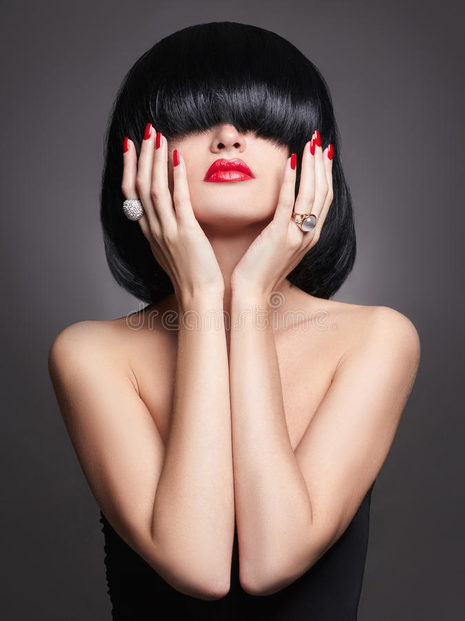 Girl with bob hair and jewelry royalty free stock photos