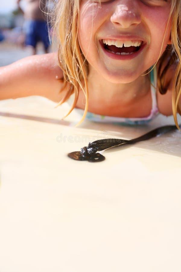 Girl bodyboarding stock photography