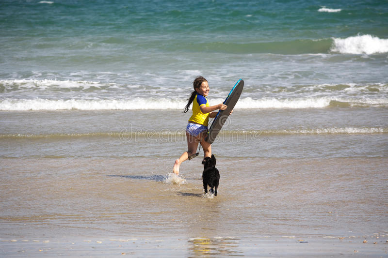 Girl With Boogie Board At Beach Royalty Free Stock Photography