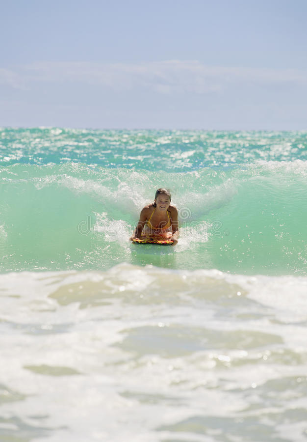 Free Girl Boogie Boarding The Waves Royalty Free Stock Images - 15700779