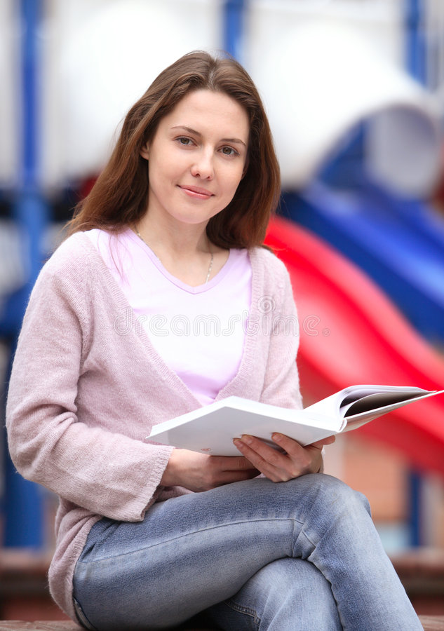 The girl with the book stock image