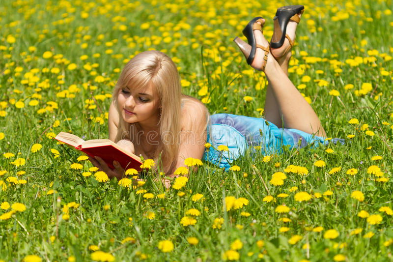 The girl with a book stock photography