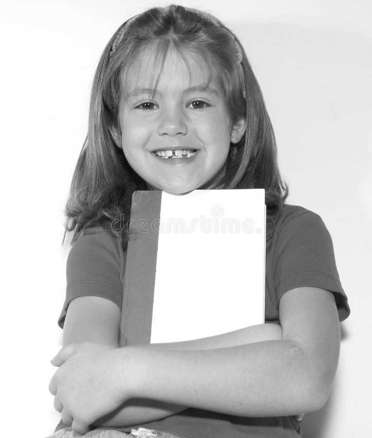 Girl with a book royalty free stock photo