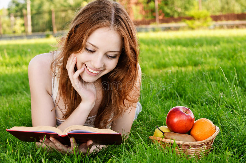 Download Girl with book and apples stock image. Image of girl - 15302393