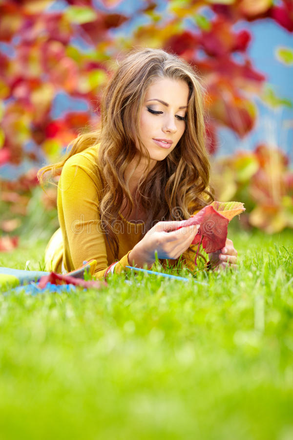 Download Girl With Book In The Autumn Park Stock Image - Image of grass, young: 27820269