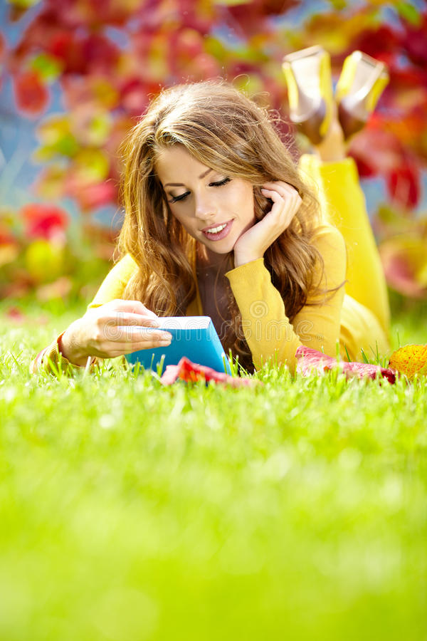 Download Girl With Book In The Autumn Park Stock Photo - Image: 27820366