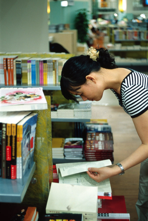 Girl in book shop royalty free stock images