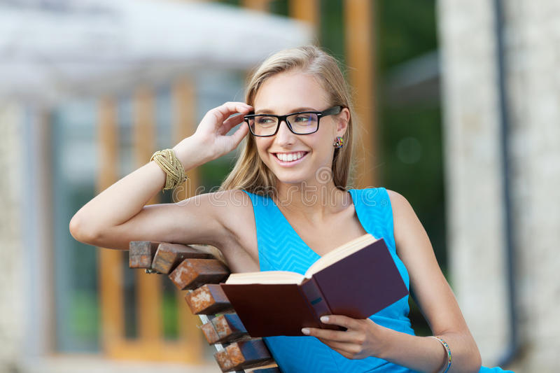 Girl with a book. Smiling girl with a book stock photos