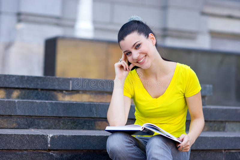 Download Girl With Book On The Stairs Stock Photo - Image: 10744582