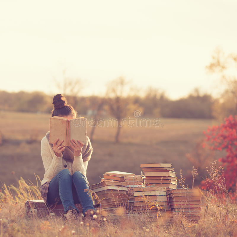 Girl with books. In fall