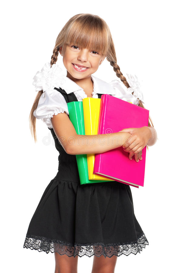 Girl with books. Little girl holding pile of books, isolated on white background stock photography