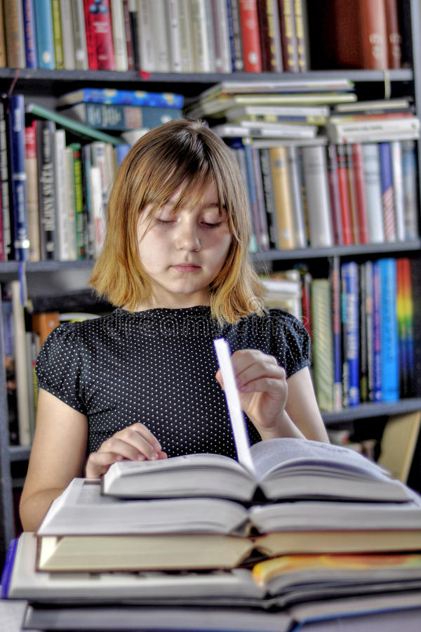 Girl and books. Stack of books and girl students royalty free stock photo