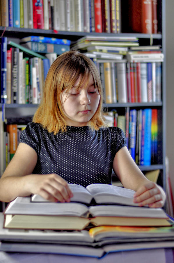 Girl and books. Stack of books and girl students royalty free stock images
