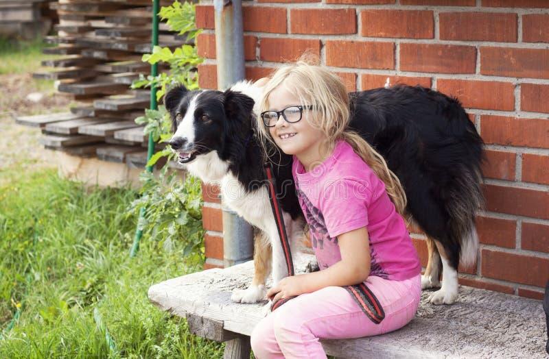 Girl with Border Collie dog on farm royalty free stock photos