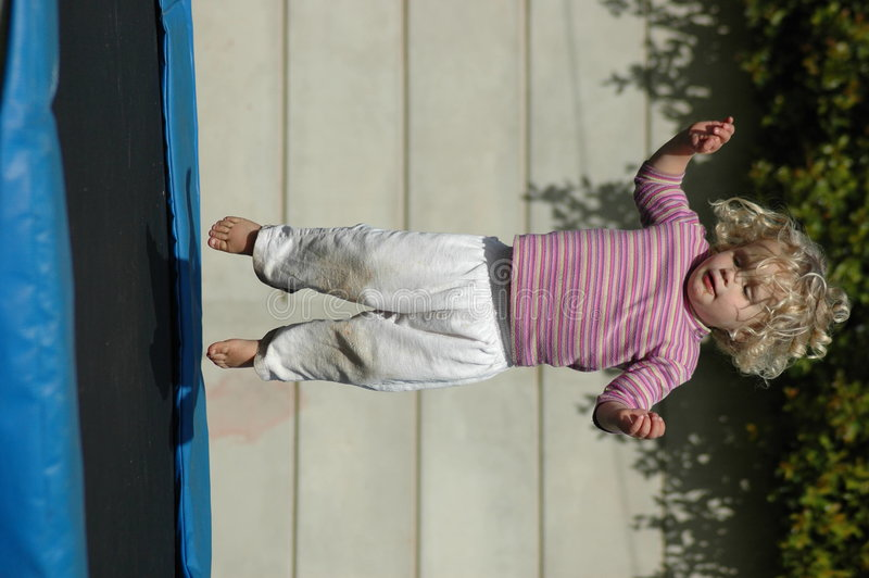 Download Girl Bouncing On Trampoline Royalty Free Stock Photos - Image: 3638558
