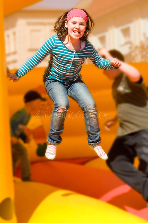Girl on the bouncy castle stock images
