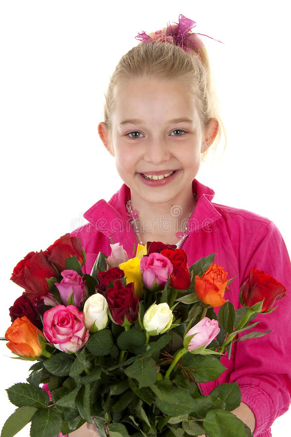 Girl with bouquet of colorful roses. Young blonde girl with colorful bouquet of roses for mothers day over white background royalty free stock image