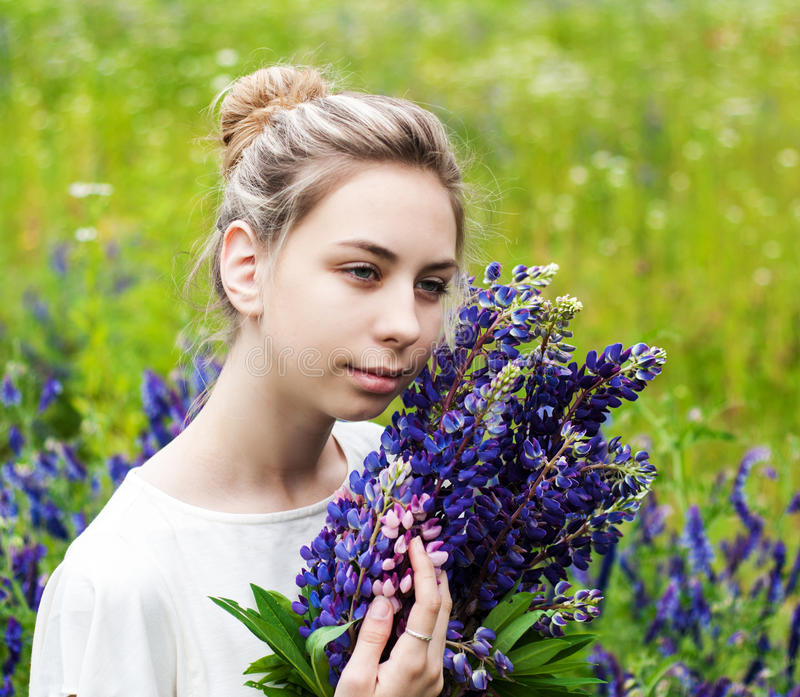 Girl with bouquet of lupine flowers stock photos