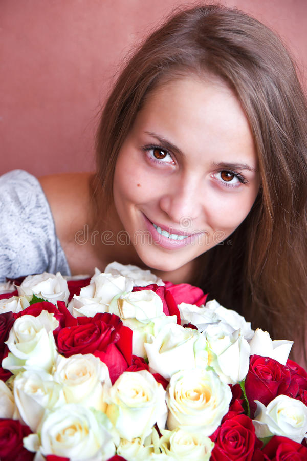 A girl with a bouquet of roses. royalty free stock image