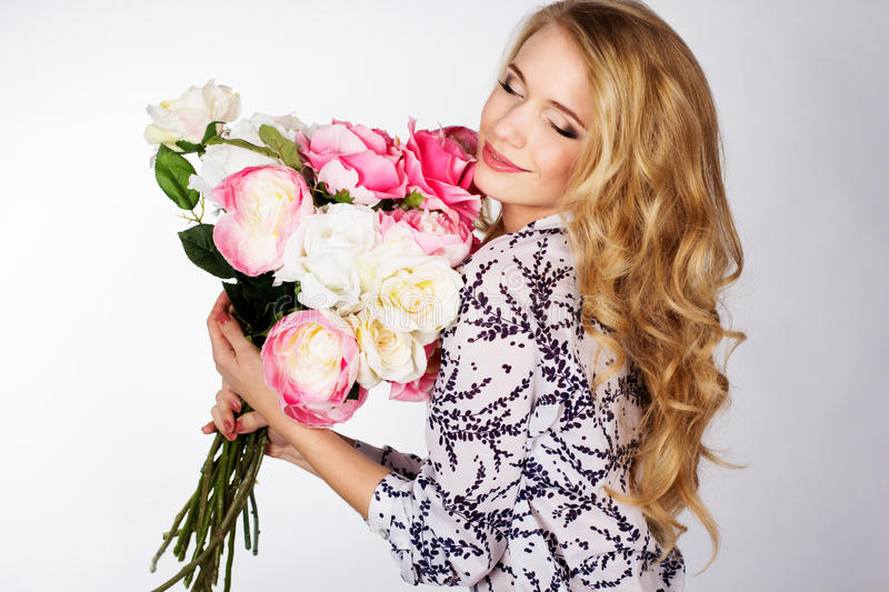 Girl with bouquet of roses. Happy smiling girl with bouquet of roses royalty free stock photo