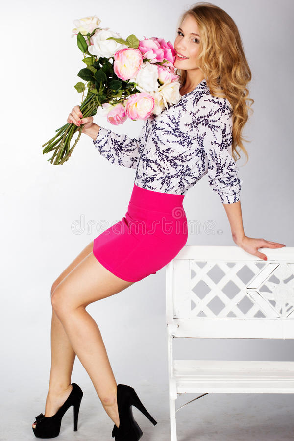 Girl with bouquet of roses. Happy smiling girl with bouquet of roses royalty free stock image
