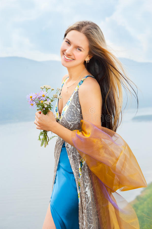 Download Girl With A Bouquet Of Wild Flowers Stock Photo - Image of flower, lifestyle: 21102246