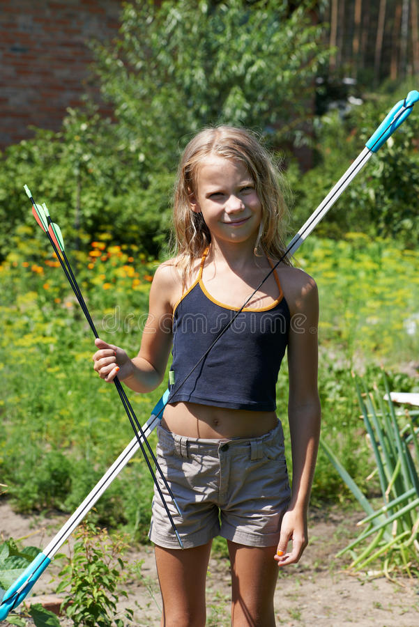 Girl with bow and arrows stock image