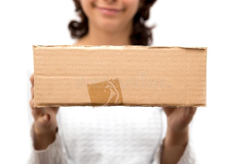 Girl with a box on a white background royalty free stock images