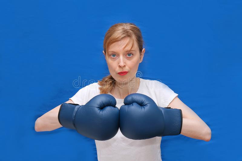 Girl boxer in blue arena stock images