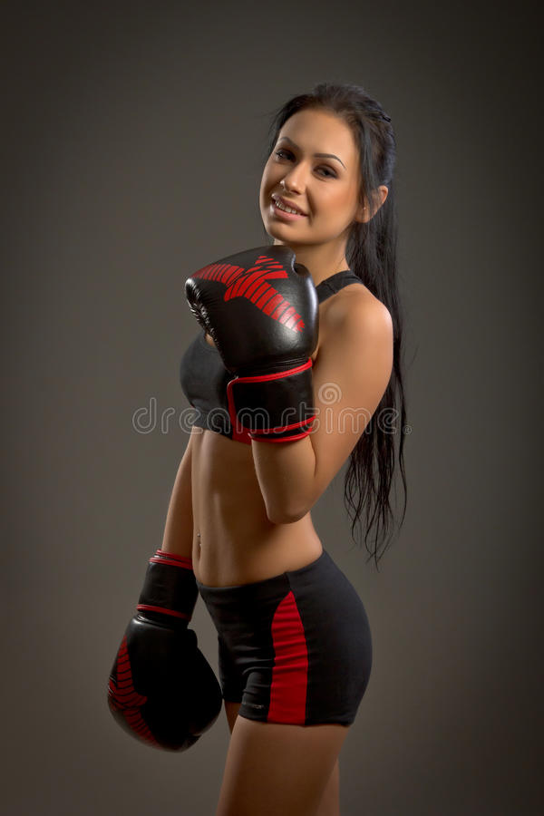 Girl boxer on a dark background royalty free stock images