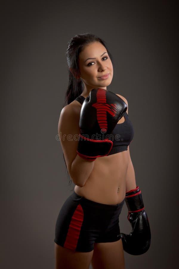 Girl boxer on a dark background stock photo