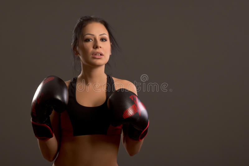 Girl boxer on a dark background royalty free stock photo