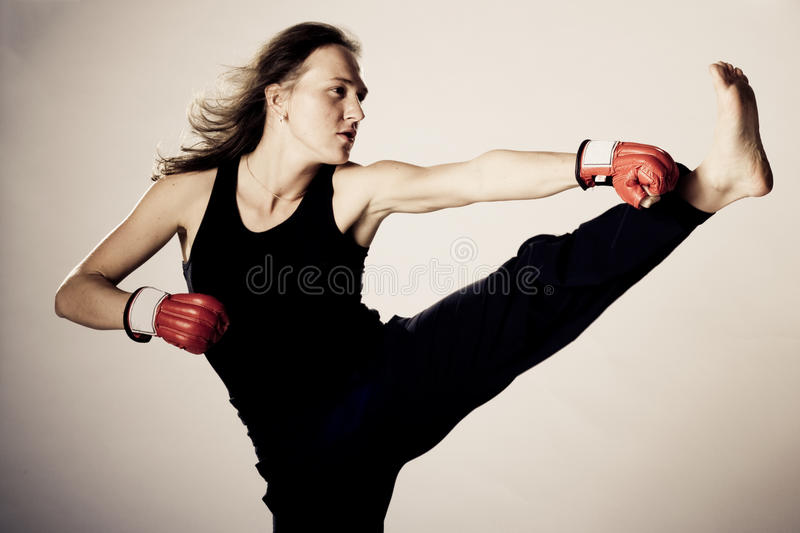 Girl with boxing gloves. In motion stock photography