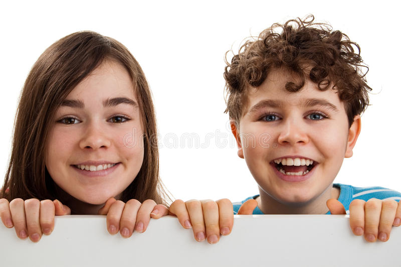 Girl and boy holding blank board. Isolated on white background royalty free stock image
