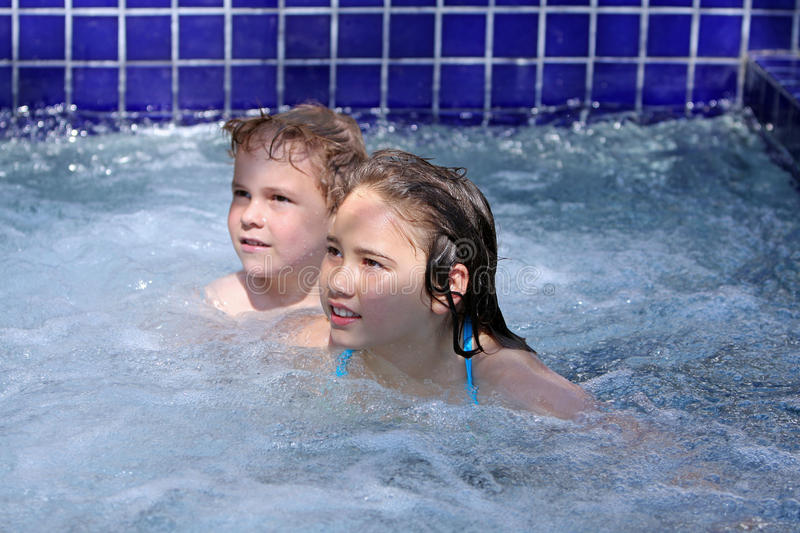 Girl and boy in jacuzzi royalty free stock photo