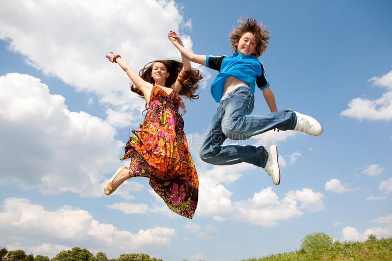 Girl and boy jumping royalty free stock photos