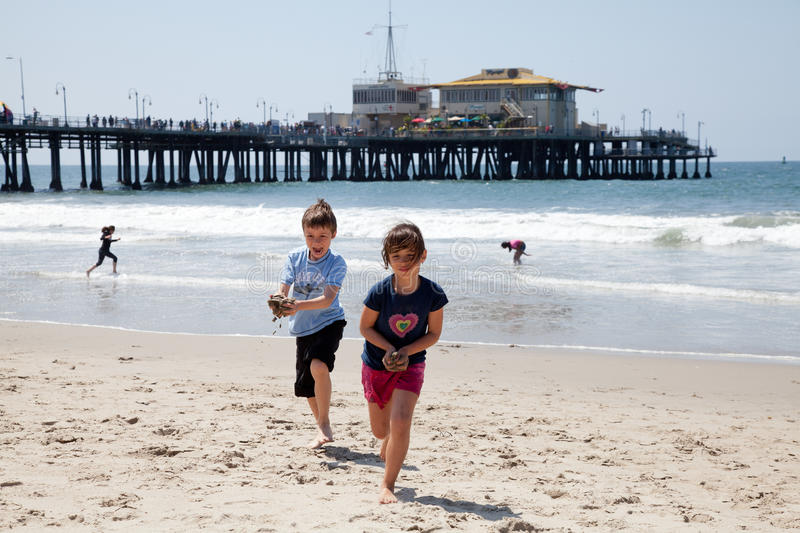 Download Girl And Boy Playing On The Beach Stock Photo - Image: 23405008
