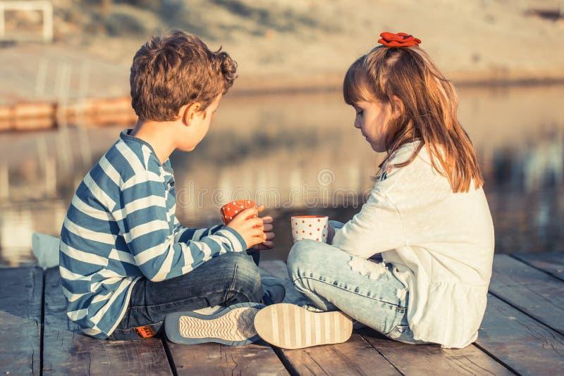 Children enjoy the lake royalty free stock photos
