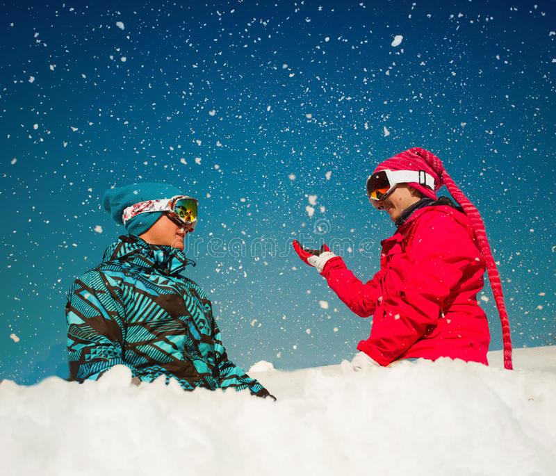 Girl and boy playing with snow royalty free stock images