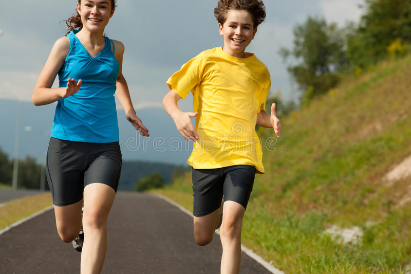 Download Kids Running, Jumping Outdoor Stock Photo - Image: 29889420