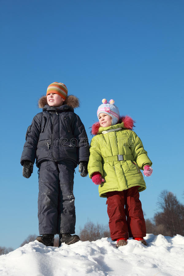 Girl And Boy Standing At Snow Stock Image