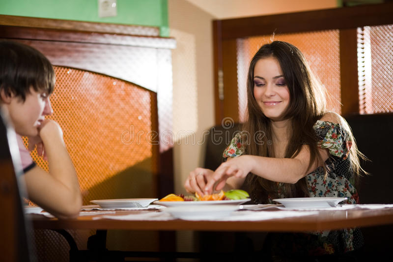 Download Girl And Boy At Table Together Stock Photo - Image: 13122242