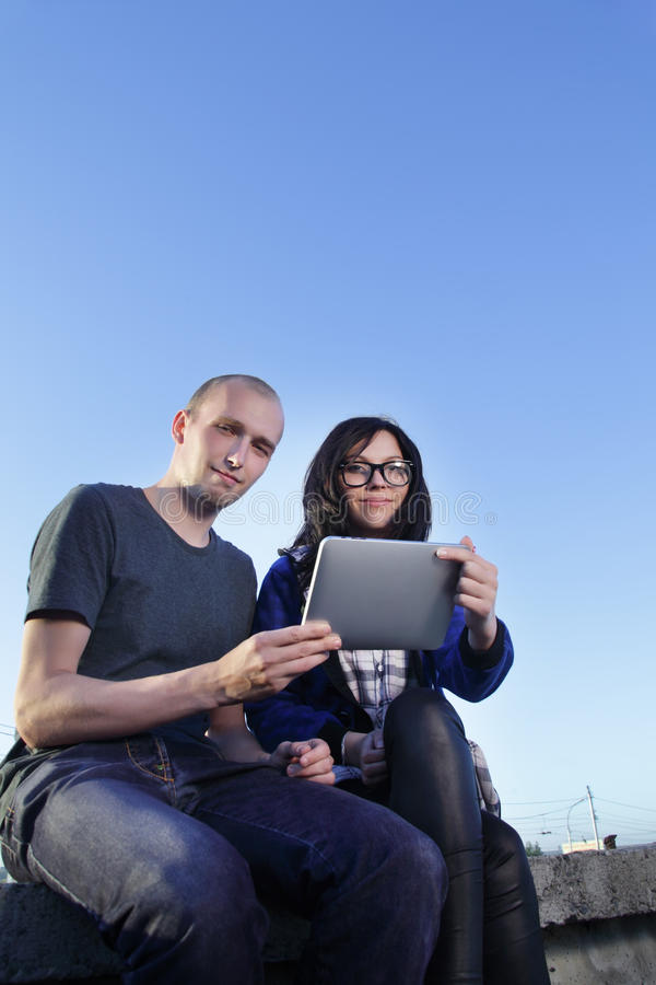 Girl and boy with tablet pc stock images