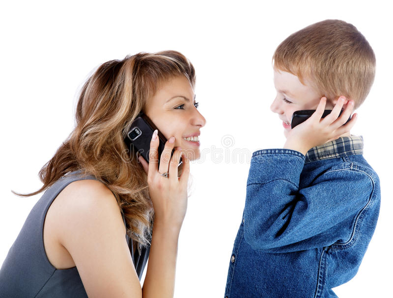 Girl and boy talk by a cellular telephone stock photo