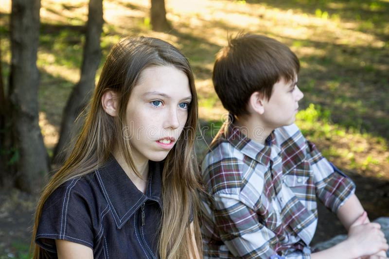 Girl and boy are Teens mad at each other. Difficult relationships, adolescence royalty free stock images